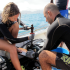 Reef Rescuers Louise Malaise L and Phanor Montoya R breaking a coral into several pieces for the underwater coral nursery